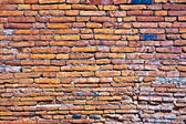 Wall of red old bricks in a temple area — Stock Photo