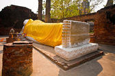 Lying Buddha dressed in yellow scarf in temple Wat Yai Chai-mong — Stock Photo