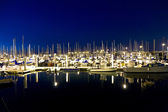 Sailing boats in the windless harbor at the pier by night — Stok fotoğraf