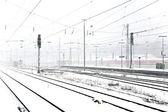Train in Wintertime on track in snow flurry — Stock Photo