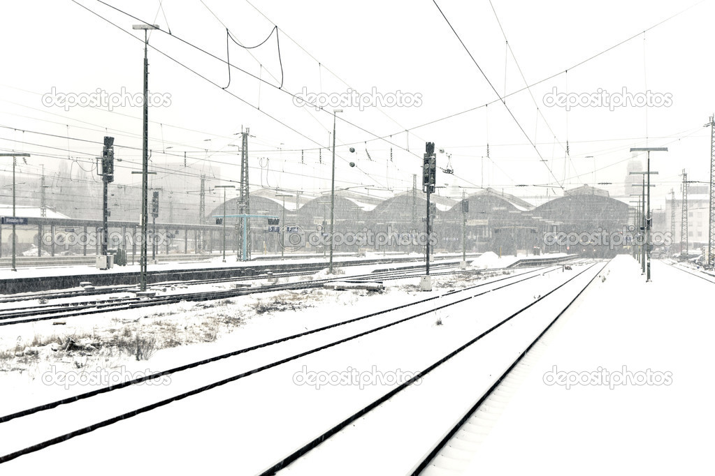 Train in Wintertime on track in heavy snow flurry — Stock Photo #5535949