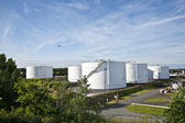 White tanks in tank farm with blue sky — Stock Photo