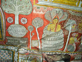 Buddah and painting in the famous rock tempel of Dambullah — Stock Photo