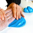 Stock Photo: Hand physiotherapy to recover broken finder