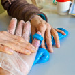 Hand physiotherapy to recover a  finger — Stock Photo
