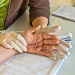 Stock Photo: Hand physiotherapy to recover finger