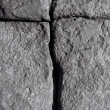 Volcanic stone with cracks forming a cross - Stock Photo
