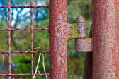 Rusty hinge at a gate — Stock Photo