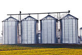 Silver silos in the field — Stock Photo