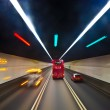 Beautiful red english bus in a tunnel in Hongkong — Stok fotoğraf