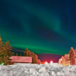 Northern lights (aurora borealis) display by night — Foto de Stock   #5615489