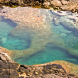 Natural pool at the coastside of lanzarote in nature - Stock Photo