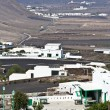 View to typical old houses in Yaiza in volcanic area, Lanzarote - Zdjęcie stockowe