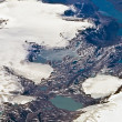 Birds view from the plane to the glaciers and mountains of the a — Foto Stock