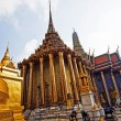 Stock Photo: Famous temple PhrSri RatanChedi covered with foil gold in th