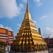 Famous temple Phra Sri Ratana Chedi covered with foil gold in th - Stock Photo