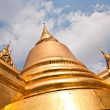 Stock Photo: Famous temple PhrSri RattanChedi covered with foil gold in t
