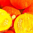 Fresh pumpkin cut half and half on the fruit market - Stock Photo