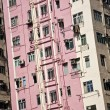 Facade of houses downtown Kowloon with appartments and air condi - Stock Photo