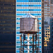 Stock Photo: Old wooden water tower