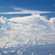 Stock Photo: Puffy white cloud blue sky