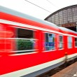 Train leaves the station with speed — Stock Photo #5618312