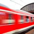 Train leaves the station with speed — Stock Photo #5618320