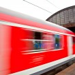 Train leaves the station with speed — Stock Photo