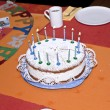 Birthday cake at the table - Stock fotografie