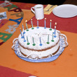 Birthday cake at the table - Stockfoto