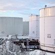 White tanks in tank farm with snow in winter — Stock Photo #5619114