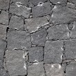 Typical wall made seamless from volcanic stone — Stock Photo #5619315