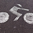 Signs for bicycle lane are painted on the street — Stock Photo