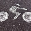 Signs for bicycle lane are painted on the street — Stok fotoğraf