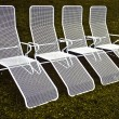 Chairs in harmonic row — Stock Photo