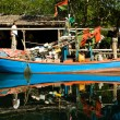 Stock Photo: Huts and colorful fisherboats at the mangrove everglades in a s