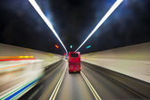 Beautiful red english bus in a tunnel in Hongkong — Stock Photo
