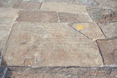 Old historic inscription in the baseplates at the dagoba Isurumuniya viha — Stock Photo