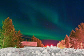 Northern lights (aurora borealis) display by night — Stock Photo
