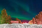 Northern lights (aurora borealis) display by night — Stock Photo