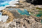 Natural pool at the coastside of lanzarote in nature — Stock Photo
