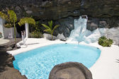 Swimming pool in natural volcanic rock area — Stock Photo