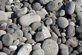 Volcanic stones at the beach formation — Stock Photo