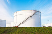White tanks for petrol and oil in tank farm with blue sky — Stock Photo