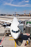 Aircraft at the finger in the airport — Stock Photo