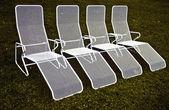 Chairs in harmonic row — Stock Photo