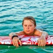 Royalty-Free Stock Photo: Boy exhausted from surfing