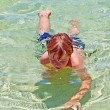 Royalty-Free Stock Photo: Boy has fun in the clear atlantic ocean