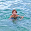 Child is swimming in the ocean — Stock Photo #5629973