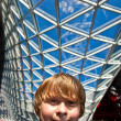 Smiling boy inside a center — Stock Photo #5630041